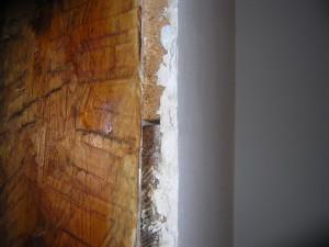 Оштукатуренная поверхность деревянной стены